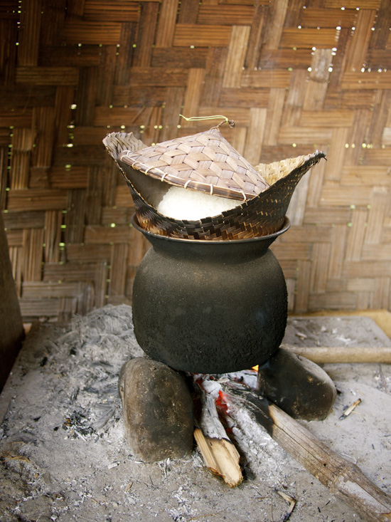 Rice steaming in a traditional 'houd' - a Lao bamboo cooking vessel