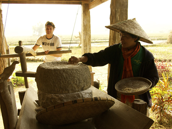 Grinding of rice by hand powered in between large stones