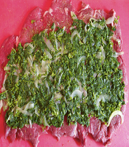 cooked spinach and onions layered over pounded meat for Argentinian matambre