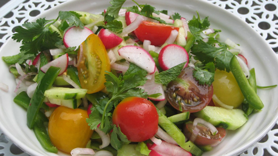 Tomato, cucumber, radish and herb salad. Also known as kachumber or Indian chopped salad