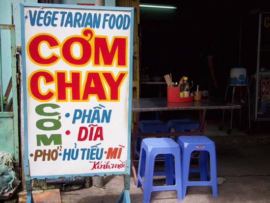 A sign for vegetarian food 'cơm chay' at a small restaurant in the central city of Huế.