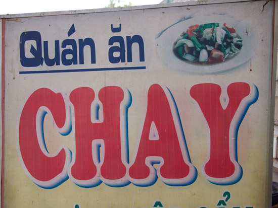 A sign for a vegetarian restaurant in Vietnam. 'Quán Ăn' is also another name for restaurant or diner in Vietnamese. It's more commonly used in the south and center of the country.